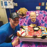 Skater John Coughlin with patient at Children's Mercy Hospital