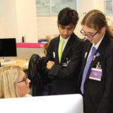 Students learning from Hallmark UK employees