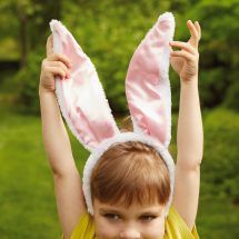 Child with bunny ears