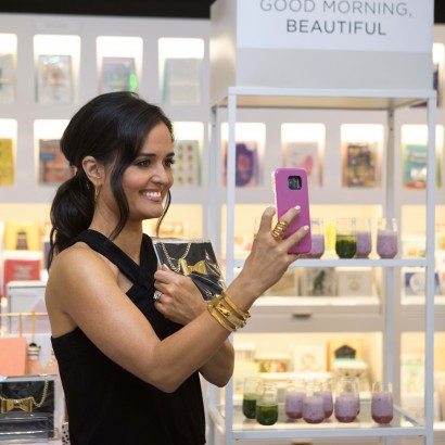 Danica McKellar takes a selfie with Hallmark Signature card