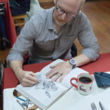 Hallmark Cards' master artist and illustrator, Geoff Greenleaf on set